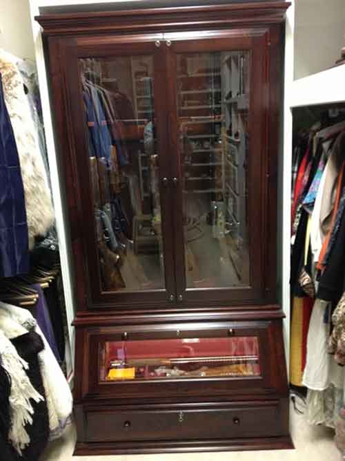 Amish custom profile gun cabinet with angled display base - Custom display cabinets ...